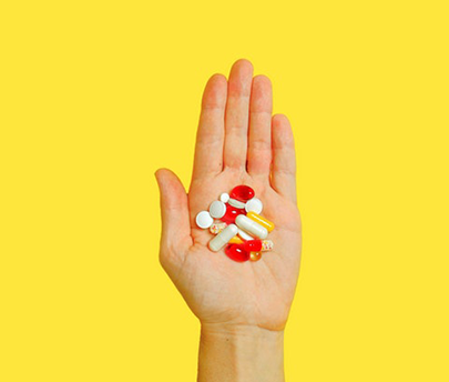 Person hand's filled with pills
